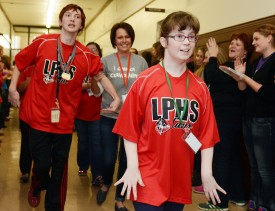 Vince Mertest (left) and Maegan Walton receive a State Send-Off at LaSalle-Peru Township High School before the Special Olympics Illinois  State Bowling Tournament.