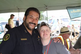 Maple Park Police Chief Mike Acosta with a Special Olympics athlete