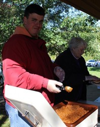 Dan James and his mother Judy serve meals to bike riders