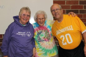 David Long is shown with his mother, Pauline Bailey, center, and friend Susan Hopkins, who drove from Ohio to watch him play volleyball