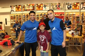 Aidan, shown with two Finish Line employees, wears his new Chicago Bulls hat