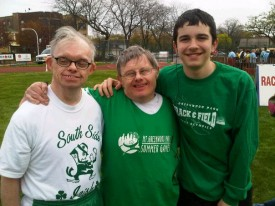 Kevin O'Brien, center, with a fellow athlete and his great-nephew Michael (right)