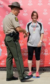 Michelle Kendall receives a gold medal for the pentathlon at 2015 Summer Games