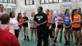 Meridian High School volleyball coach, Tony Holly, speaks to his players and Special Olympic Illinois athletes.