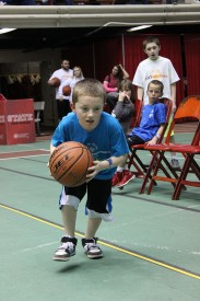 Nicholas Jess participates in Young Athletes individual skills at State Basketball Tournament