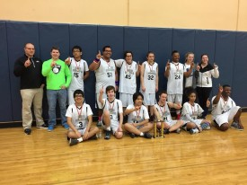 The District 99 Hoops 2 team with their trophy at District competition which earned them the right to compete at state level