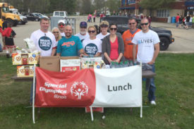 John Davis and his volunteer crew from Walgreen's serve lunch at East Central/Area 9's Spring Games.