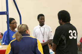 Official Orintho Farris Jr. talks with athletes prior to a volleyball game at Fall Games